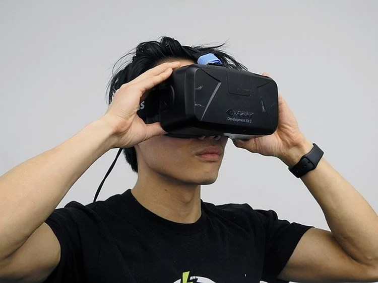 This shows a person in virtual reality glasses