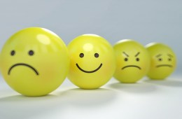 This shows a happy face ball with other sad face balls