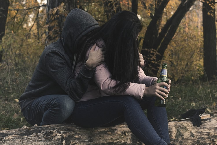 This shows a young man and woman drinking