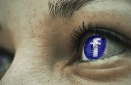 This shows a woman with the facebook logo in her eye