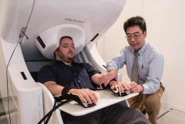 This shows a patient in an MEG machine