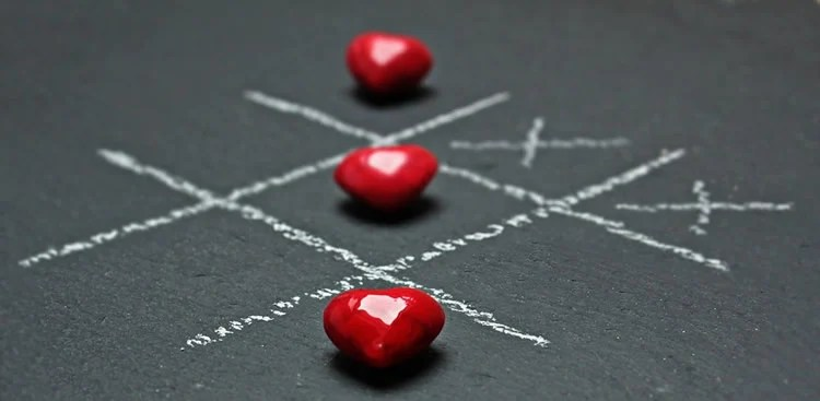 Hearts are shown as pieces on a tic-tac-toe board