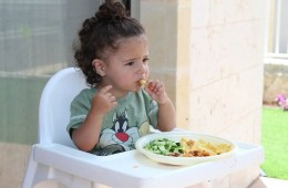 This shows a small child eating