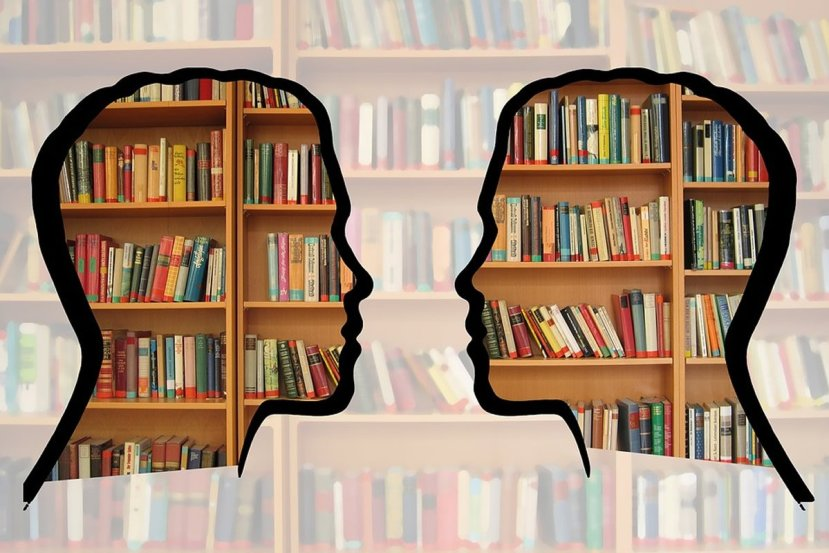 This shows two heads and books