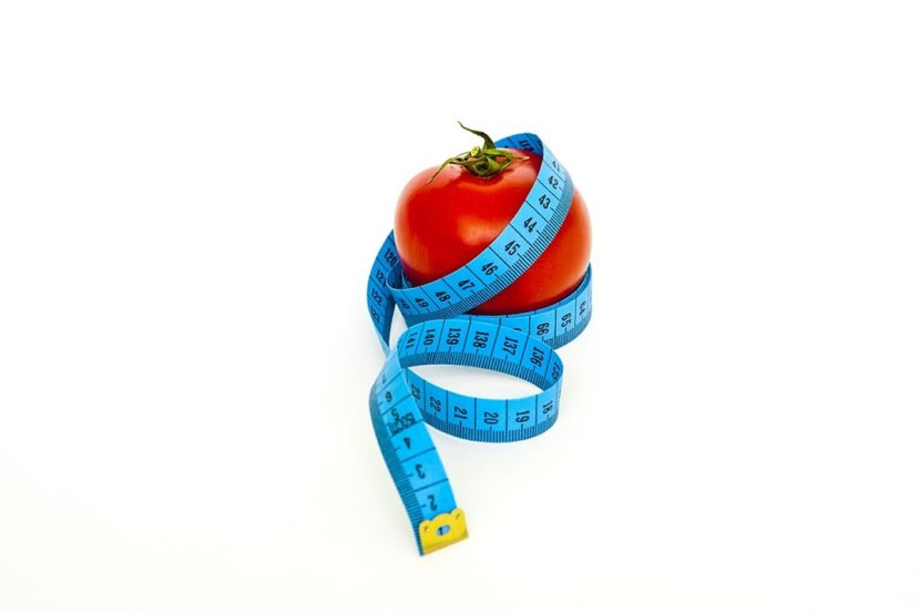 This shows a tomato and measuring tape