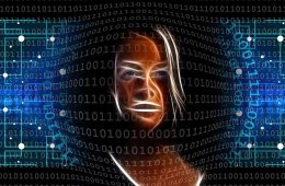 This shows a woman's face and binary code