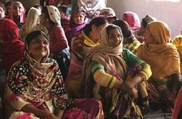 This shows a group of ladies in India learning to read
