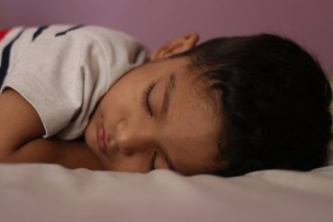 This shows a little boy sleeping