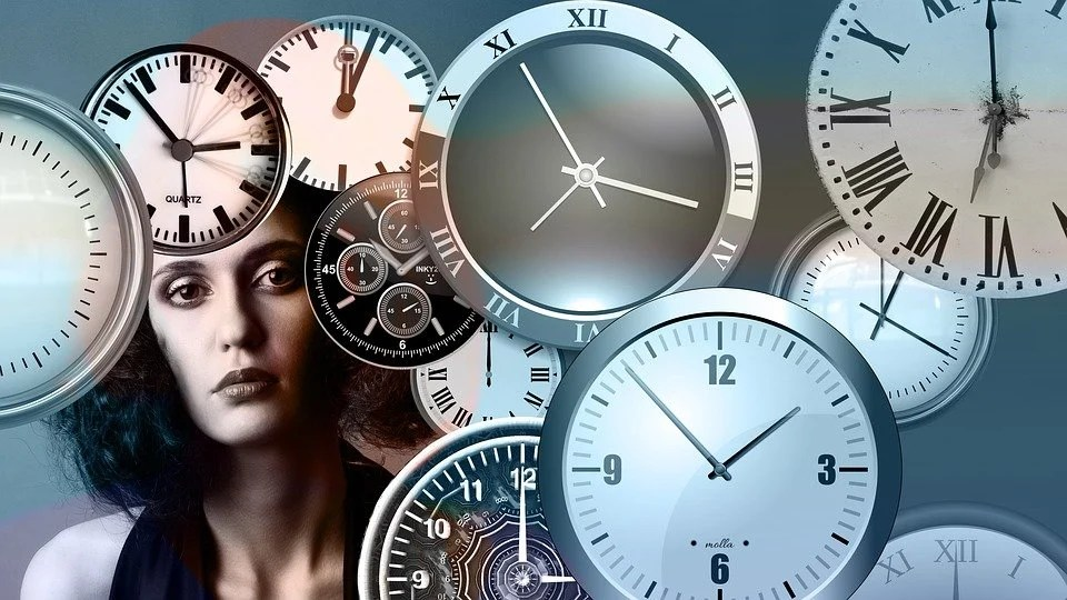 This shows a woman and clocks