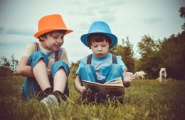 This shows two little boys reading