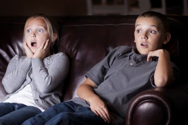 This shows kids watching a movie
