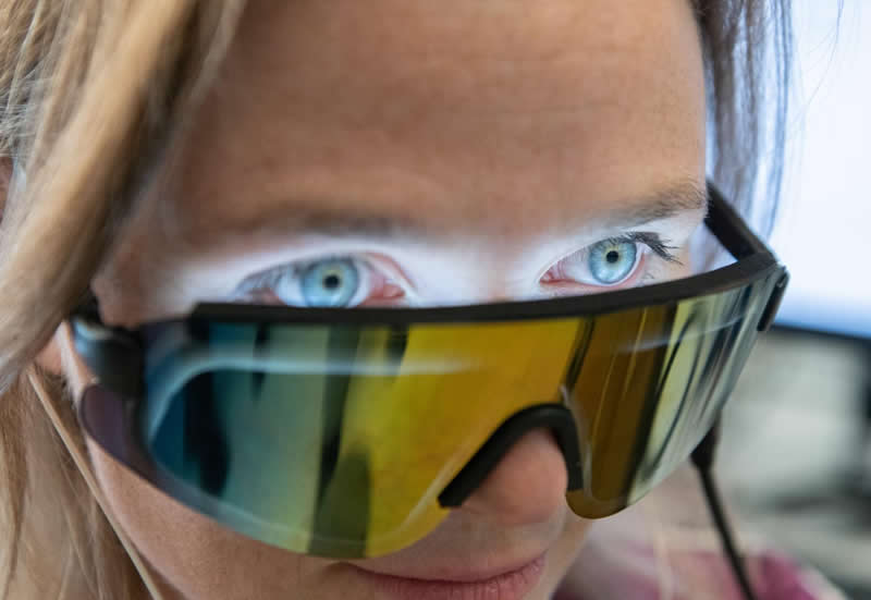 This shows a woman wearing the light glasses