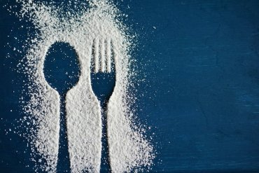 This shows a sugar outlined spoon and fork