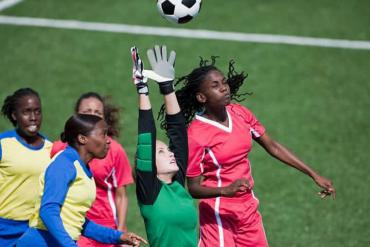 This shows women playing soccer
