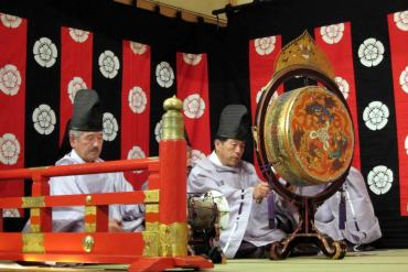 This shows musicians playing traditional japanese instruments