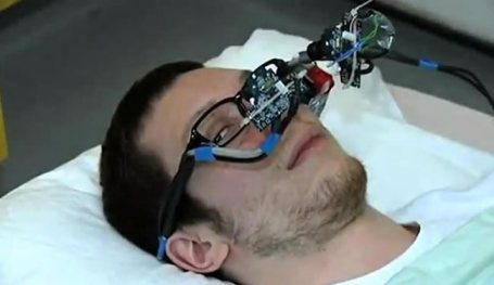 A man has glasses on with the eye tracking system attached.