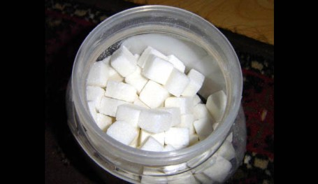 A bowl of sugar cubes is shown.