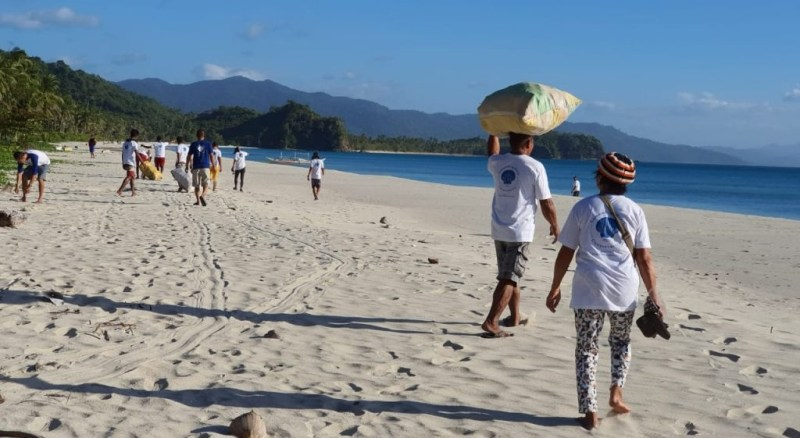 Coastal cleanup by locals at Lumambong Beach