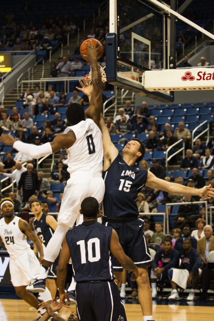 Quinsey Sablan/Nevada Sagebrush Nevada forward Cam Oliver (0) goes up for a huge slam over LMU's Stefan Jovanovic (15). Nevada beat LMU 79-64.