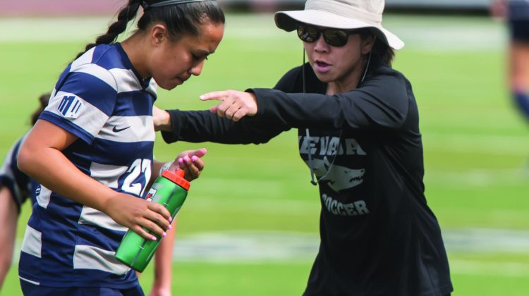 Wolf Pack Women's Soccer head coach Erin Otagaki discusses tactics with Nevada forward Morgan Beye. Otagaki is prepping her team for their upcoming campaign by holistically developing her players.