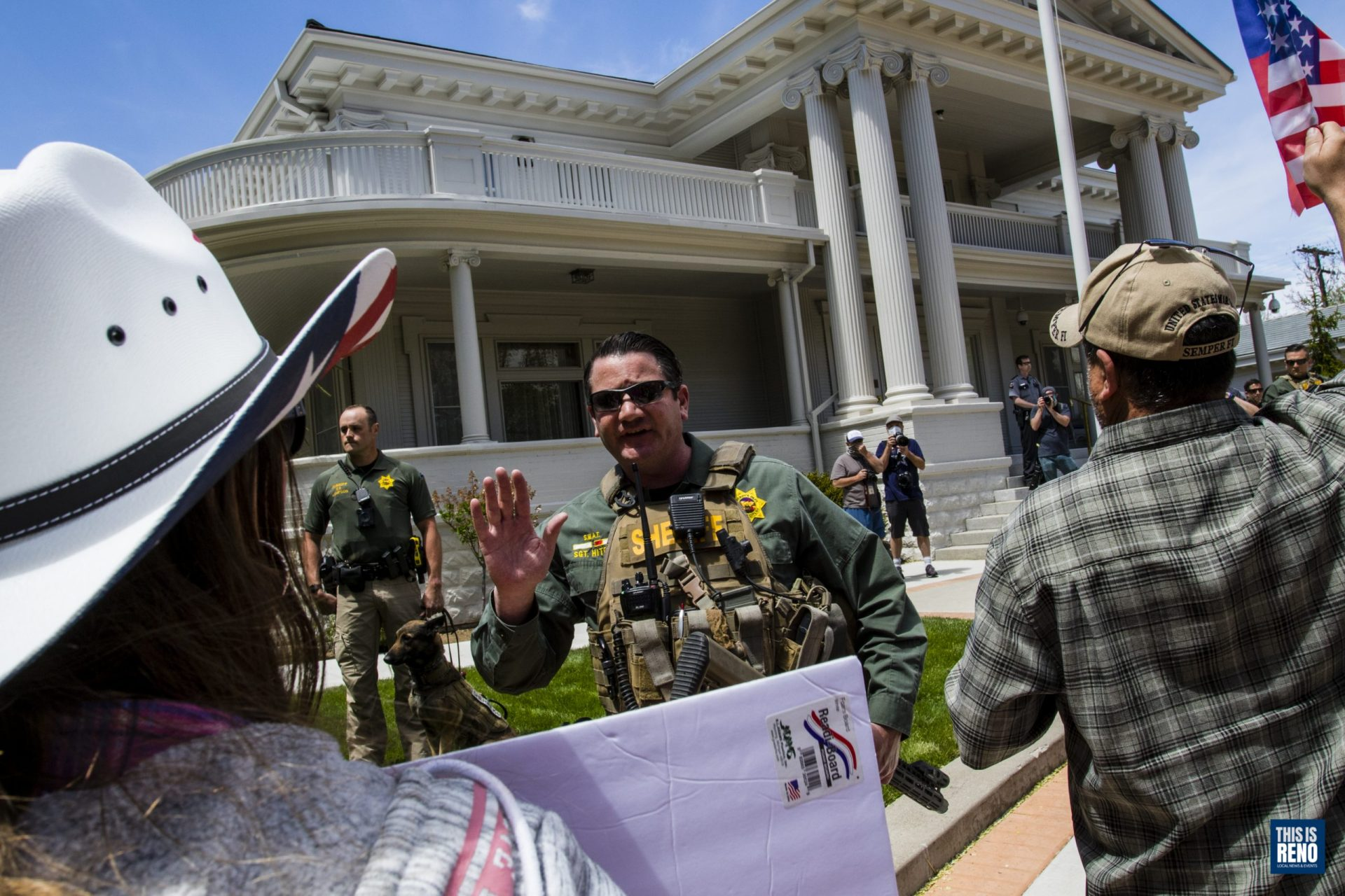 Law enforcement kept back protesters May 2 at the Governor's Mansion during a protest to reopen Nevada and recall Gov. Sisolak. Image: Ty O'Neil