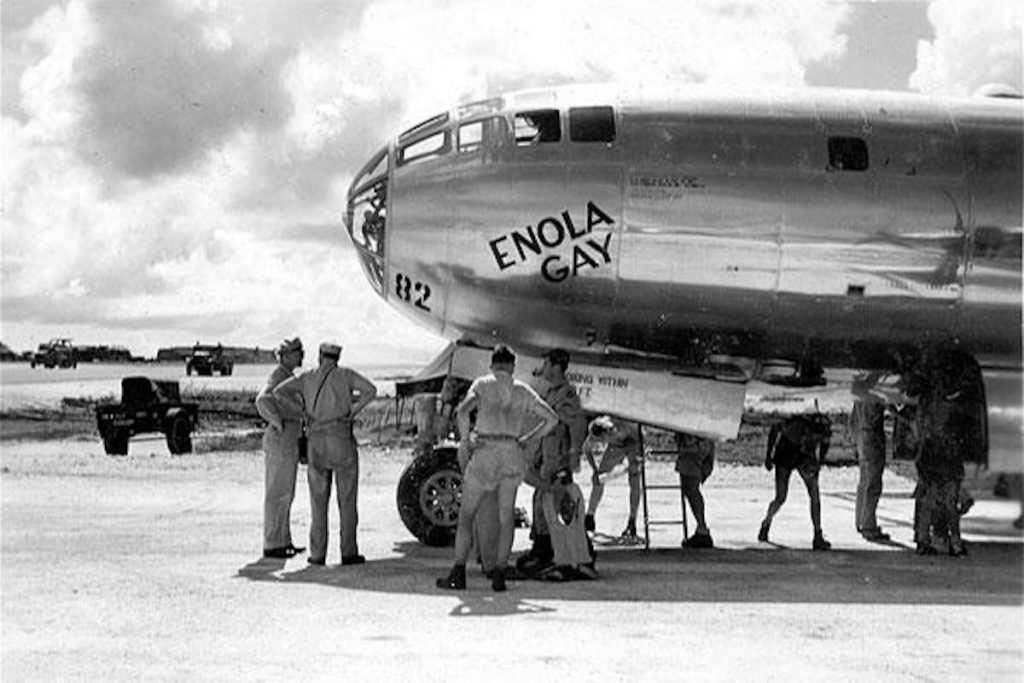 The Enola Gay crew checks out the B-29 Superfortress on Tinian Island, days before the aircraft dropped the first atomic bomb on Aug. 6, 1045, on Hiroshima, Japan. Wikimedia Commons