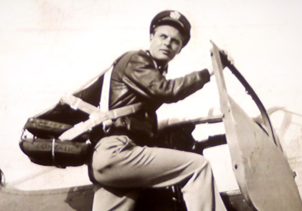Lt. Lowell Twedt begins to climb inside a plane during World War II. Courtesy of Twedt family.