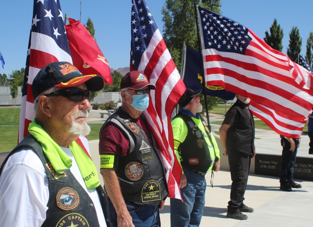 Patriot Guard Riders display numerous U.S. flags at Lt. Lowell S. Twedt's funeral on Saturday at the Northern Nevada Veterans Memorial Cemetery in Fernley. Steve Ranson / Nevada News Group