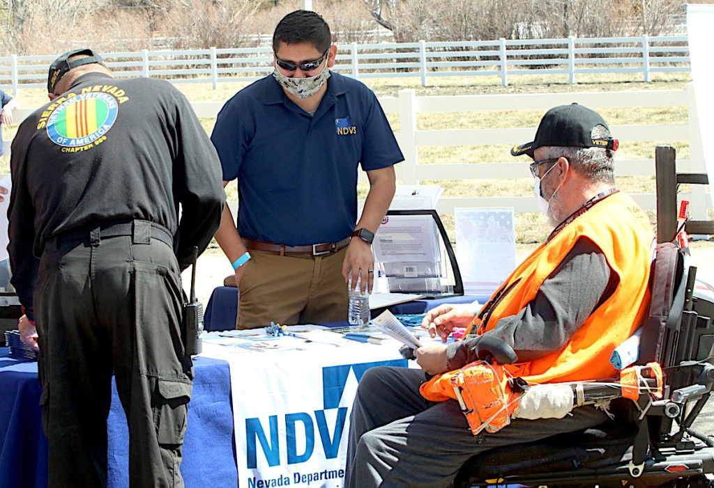 Eduardo Martinez, center, answers questions at the Nevada Department of Veterans Services outreach table. Steve Ranson / LVN