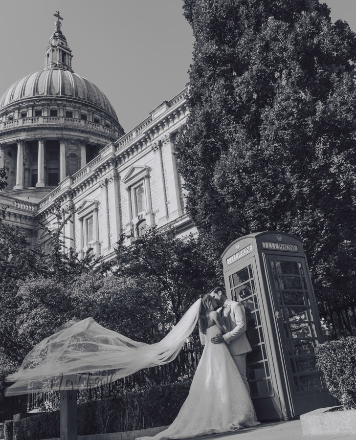 Bride-Groom-Veil-Traditional phone box-wedding-photographer-London-St. Paul's Cathedral