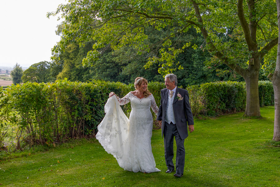 North-Yorkshire-Bride-Groom-wedding-photographer-intimate-photograph-walking-couple-stunning-gardens-