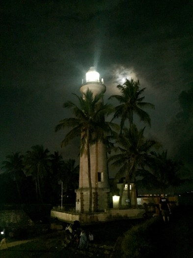 The full moon, the palm trees and the lighthouse