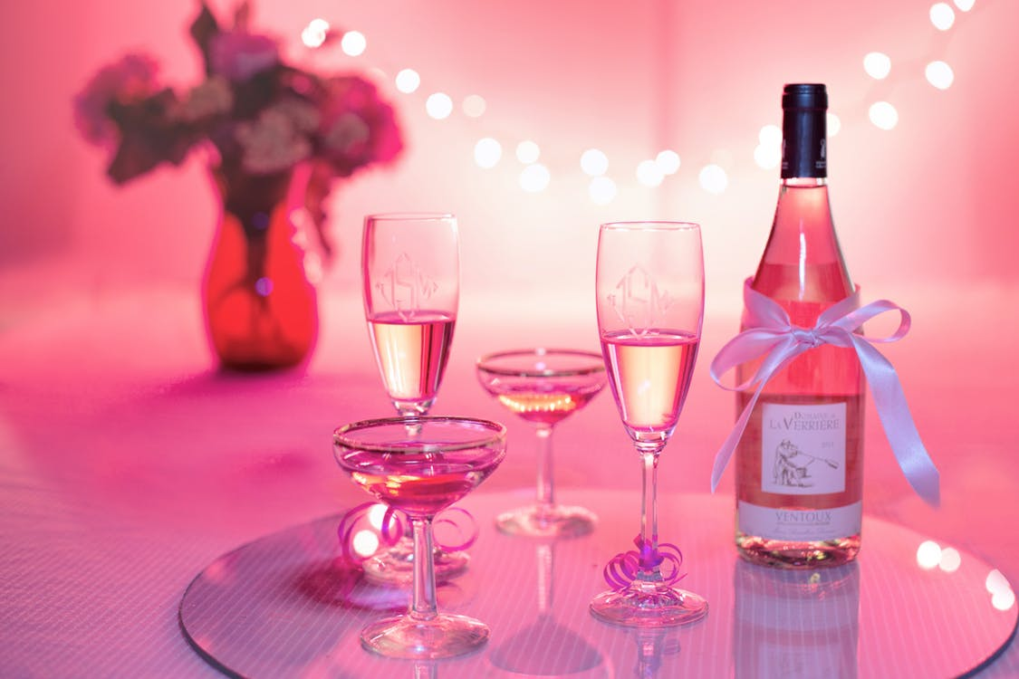 Pink wine glasses and bottle | neveralonemom.com