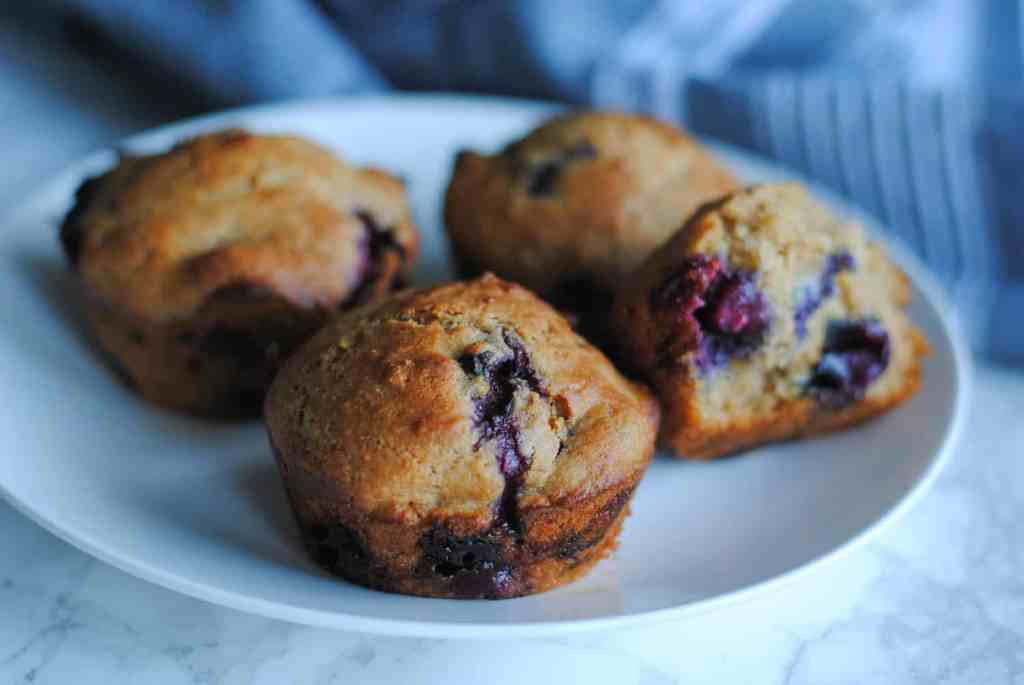 whole wheat lemon blueberry muffins on white plate