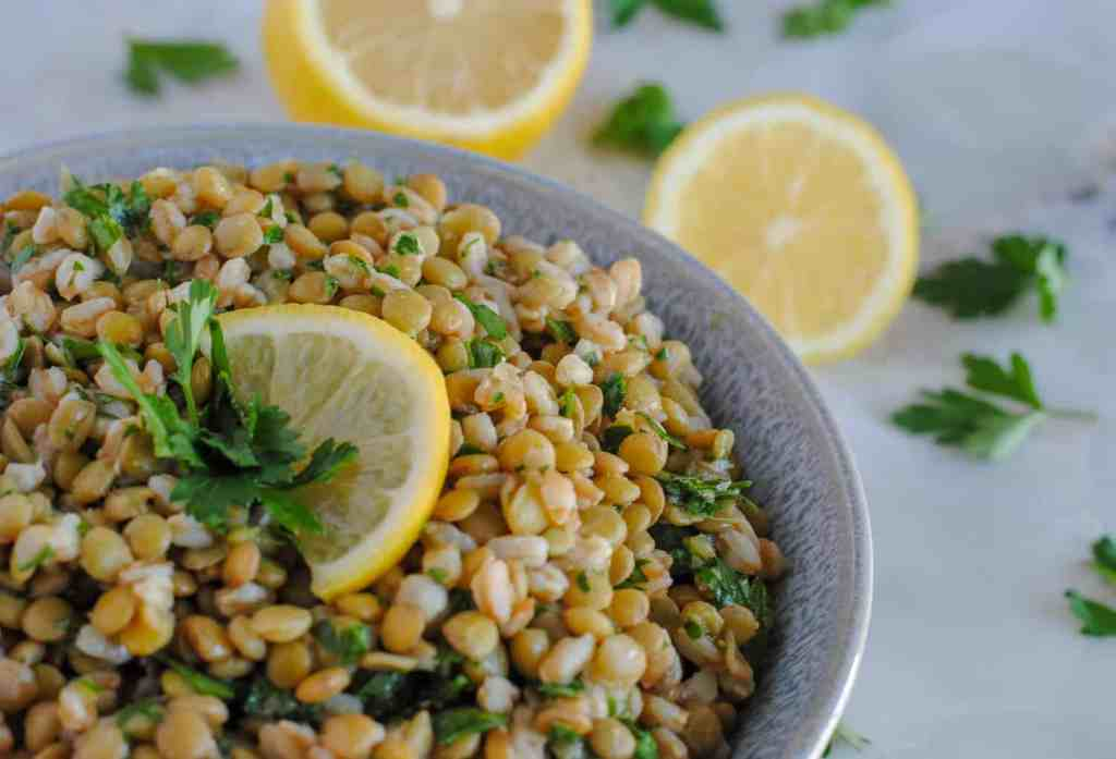 lentil and farro salad on marble background