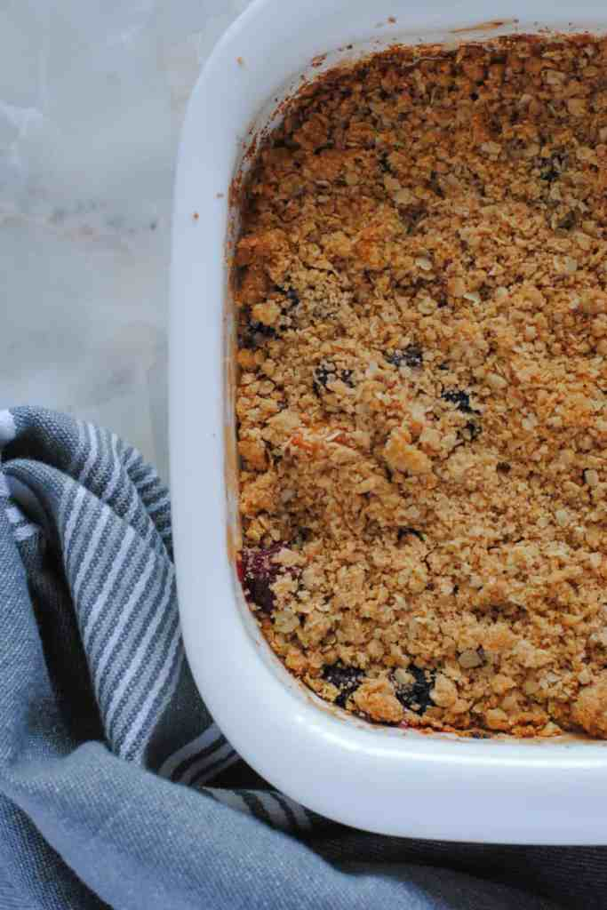 Baked blackberries, peaches and plums in a summer fruit crisp