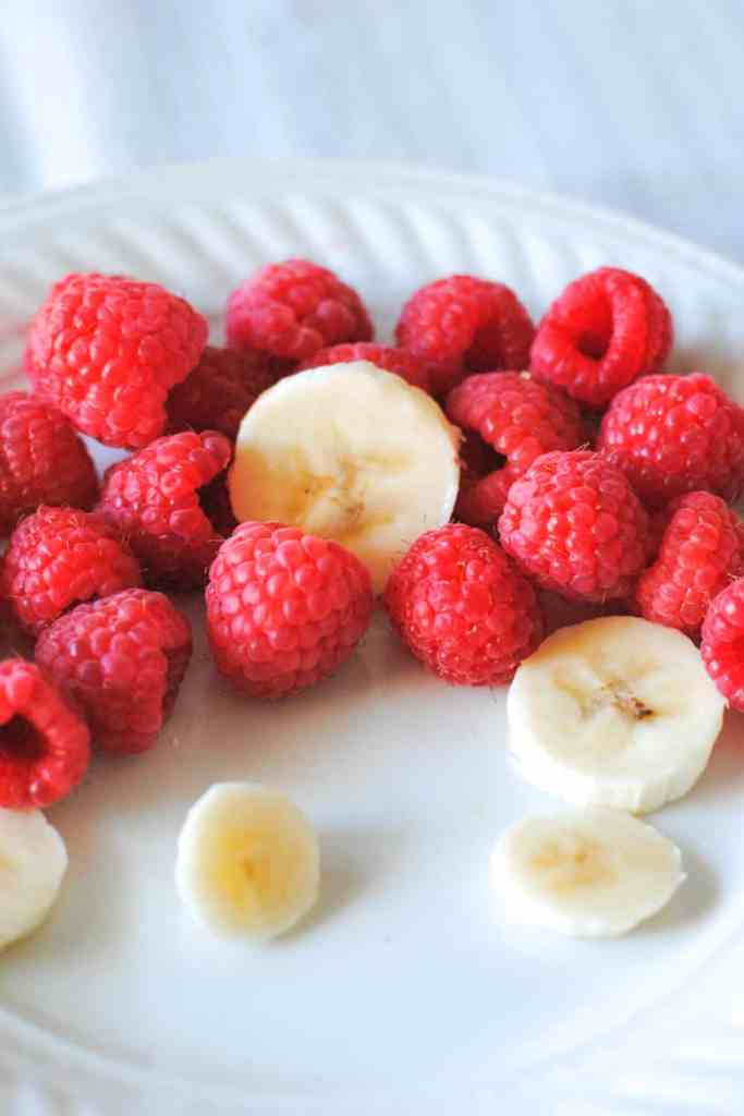 fresh raspberries and sliced banana