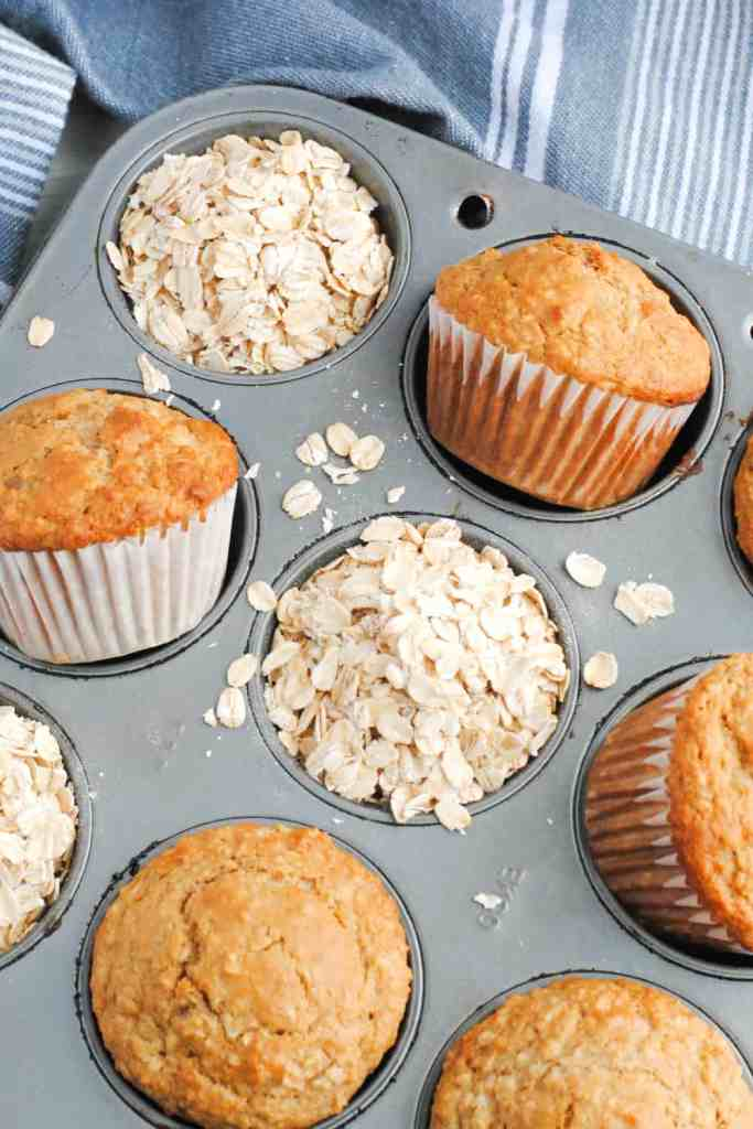 muffins and oats in gray muffin tin