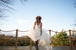 bride outdoors lifting up dress to reveal wellies