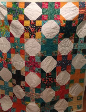 A full view of the quilt top. You can kinda see where I've quilted so far.