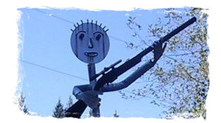 welded statue art holding rifle outside gun club