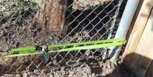 Used a ratchet to fix chain link fence