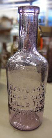 purple Newbro Herpicide bottle