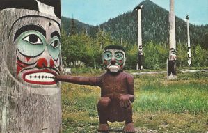 Postcard featuring a totem pole biting another totem pole.