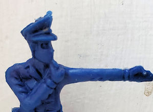 Crackerjack toy policeman.