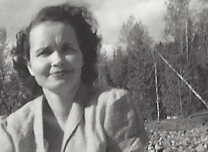Mom on a picnic in a rocky meadow.
