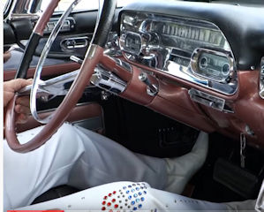 Elvis impersonator with 57 Cadillac