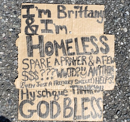 Brittany homeless sign