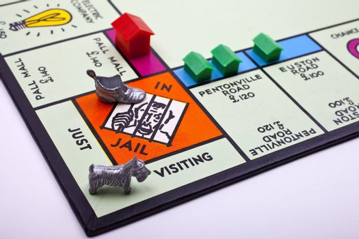 Dog visiting boot in Monopoly jail.
