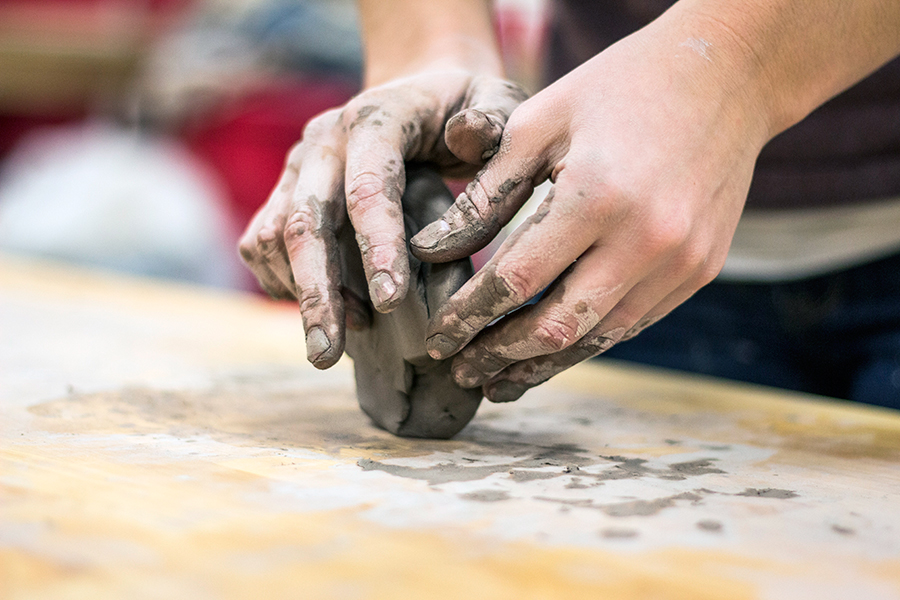 Dirty hands molding clay